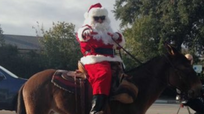 santa impersonator horseback